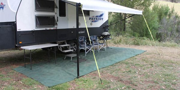 Ground dogs tie down straps attached to ground and campervans awning
